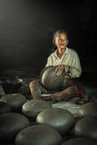 Potter  making clay pot. Stock Photo