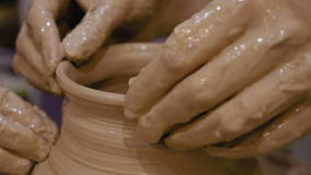 Potter is making clay pot on the potter`s wheel stock footage