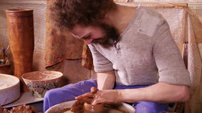 Potter making a clay vase stock video footage