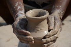 Potter in making pot for ahead of Gangour festival in Rajasthan Bikaner Stock Photo