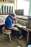 Potter 1. Hands shaping clay pot on potters wheel.Traditional ceramics specific to Marginea, Romania Stock Images