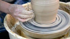 The potter molds clay jug pot closeup stock video footage