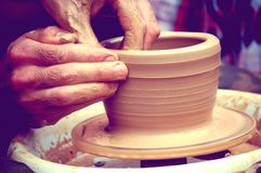 The potter molds a jug on the circle Stock Images