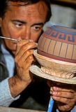 Potter- Peru. Potter brushing on application of slip (clay paint) on pot- Ollantaytambo (Sacred Valley), Peru Royalty Free Stock Photo