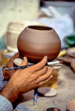 Potter- Peru. Potter's hands centering the leather-hard pot for decorating with slip Stock Image