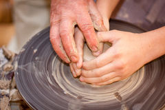 Potter on the potters wheel. Potter makes on the pottery wheel clay pot Stock Image