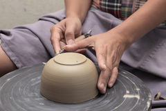 Potter's hand shaping bowl Stock Photos