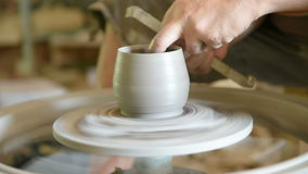 Potter`s hand, traditional making a cup product stock footage
