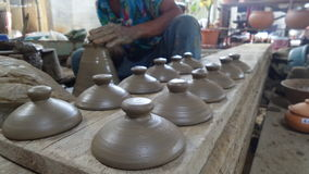 Potters hand working on spinning wheel and clay Stock Photo