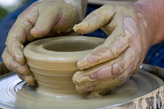 Potter's hands Stock Photo