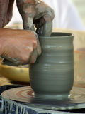 The potter's hands Stock Images