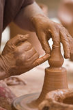 Potter's hands. Stock Photography