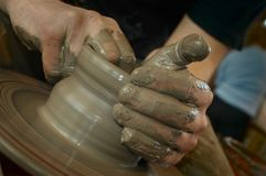 Potter's hands. At work Stock Images