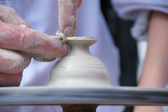 Potter's Hands. Making Clay product Stock Photo