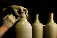 The potter's hands Stock Photos
