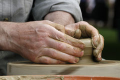 Potter's hands Stock Photos