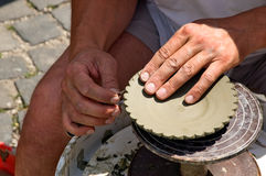 Potter's hands. Potter working clay on potter's wheel. European Folk Crafts, Slovakia Royalty Free Stock Photos