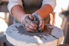 Potter is creating earthenware on potter`s wheel. royalty free stock photography