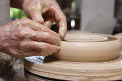 Potter's hands shaping bowl Royalty Free Stock Photo