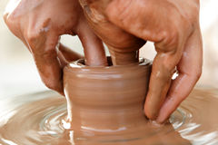 Potter's hands at work. Teacher teach his apprentice pottery Stock Images