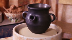 Potter's pot rotating on a spinning wheel stock video footage
