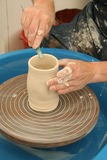Potter's Wheel. Potter at work making a pot royalty free stock photo
