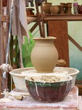 Potter's wheel. With clay jug royalty free stock photo