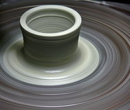 Potter's wheel. With a new pot rotating Stock Photos