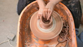 Potter`s wheel and hands stock video footage