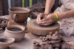 A potter shapes a piece of pottery Royalty Free Stock Images