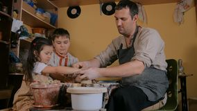 Potter showing how to work with ceramic in pottery studio stock footage