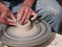 Potter spinning clay Stock Photography