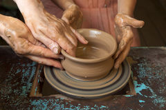 Potter teaches cooking pots Royalty Free Stock Photos