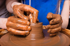 Potter teaches how make clay pot Stock Photos