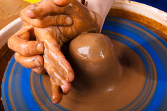Potter teaches to work with clay on pottery wheel Stock Photos
