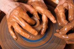 Potter teaches to work on pottery wheel Royalty Free Stock Images