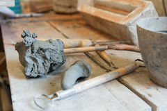 Potter tools. Ball of clay and tools of the potter Stock Images