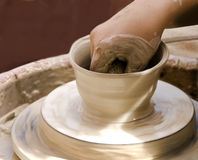 Potter at work on clay pot Royalty Free Stock Photo