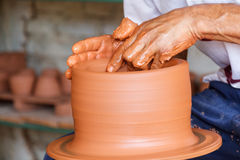 Potter at work. A potter making a pot at his workshop in Camaguey, Cuba Stock Photo
