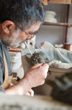 Potter at work. Restorer of vessels at work Stock Photos
