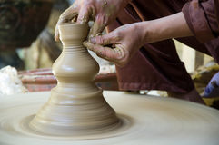 Potter working clay Royalty Free Stock Image
