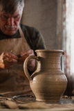 Potter working a piece of clay. Makes a jug Royalty Free Stock Images