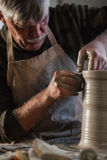 Potter working a piece of clay. Makes a jug Royalty Free Stock Photography