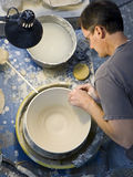 Potter working at pottery wheel Royalty Free Stock Photos