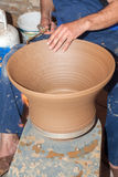 Potter works with clay in ceramics studio Royalty Free Stock Images