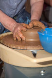 Potter works with clay in ceramics studio Stock Image