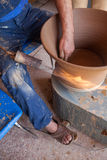 Potter works with clay in ceramics studio Stock Images