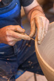 Potter works with clay in ceramics studio Stock Photography