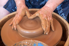 Potter works with clay in ceramics studio Royalty Free Stock Photos
