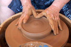 Potter works with clay in ceramics studio Royalty Free Stock Photography